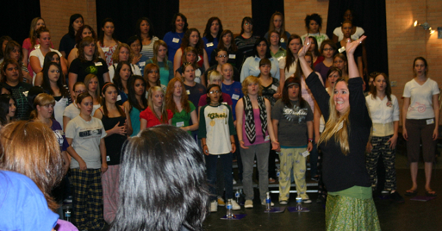 Clinician Charla Esser instructs the girl's chorus